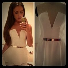 White Romper New, no rips or stains...Love it but when I ordered it I got it too small  and didn't realize the belt wasn't included but can use any fashion belt with this! Shorts