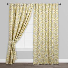 Multicolor Mosaic Concealed Tab Top Curtains.  Just bought these, they're not as yellow in person. More green and blue.