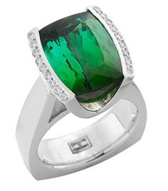 18ct White Gold Chromium Tourmaline Ring.   Cushion cut chromium tourmaline centre stone, bordered on either side by thread and grain set round brilliant cut diamonds.   Can also be made in platinum or yellow gold.   Could also feature other precious or semi precious gemstones.