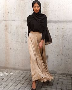 Flared silhouettes for a modest take on high-fashion:  Gold Ornate Flared Skirt  Black Crepe Top  Black Soft Crepe Hijab  www.inayah.co