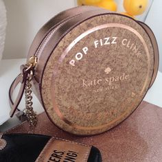 """Kate Spade Bubble Over Kate Spade Bubble Over purse with cork-like overlay 6.25""""(W) x 2.75""""(D) Chain-embellished strap with 21"""" drop Zip closure Lined interior no tradesno questions from non serious buyers or you will be blocked no price comments do not add to a bundle if you have no intentions of buying the same day or you will be blocked  no lowballing no holds  ✔️I ship the next day kate spade Bags"""