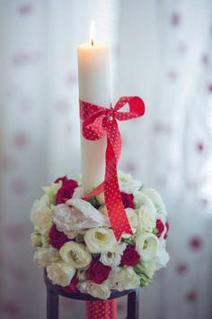 Beautifull red and white baptism candle
