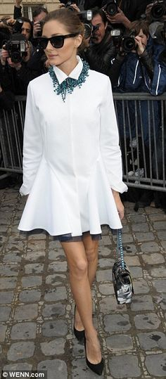 White hot: Borrowing from the collection, the former City star turned fashion blogger wore a white shirt dress featuring a ruffled skirt over black tulle
