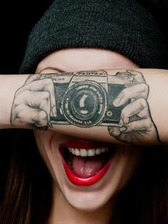 """""""Snap a photo in the stretch of an arm"""" tattoo - Asahi Pentax SLR camera in hands"""