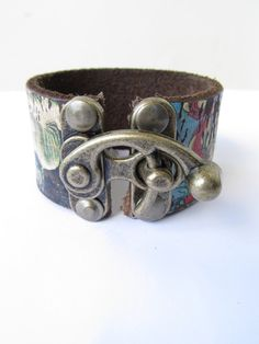 New ItemBuddha Leather Cuff with Brass Lock Buckle by LairaLou, $48.00 I'm going to need to buy this soon.