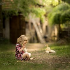cutness overload - she loved the ducky very very much, but don't worry the duck survived :)