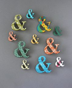 Addicted to typography? These Ampersand Pins are actually laser-cut from old hardcover books- specifically old Reader's Digest Condensed Books, outdated textbooks, and other unwanted books. Made From Books also donates to support literacy!  MADE FROM BOOKS bu Yes & Yes Designs
