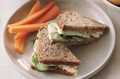 Hummus and Feta Sandwiches on Whole Grain Bread These sandwiches are portable and keep well in a lunch box. The hummus should be thick for the sandwiches, but if you want to enjoy the leftovers as a dip, thin slightly with a little extra olive oil. Hummus Sandwich, Cucumber Sandwiches, Chickpea Sandwich, Sandwich Thins, Meat Sandwich, Sandwich Ideas, Healthy Sandwiches, Sandwich Recipes, Raw Food Recipes