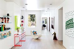 A vestibule in the children's wing features a Ron Arad rocking chair and an Alexandra von Furstenberg acrylic console.