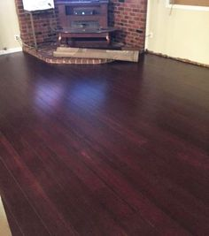 """""""This floor is affordable, easy to install, and looks stunning. I installed this in my mom's family room. I love it so much, I drove over to my mom's house to use the floor for my product advertising. I'm thinking about purchasing more for my photography studio."""" [Scarlet Night Bamboo]"""