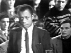 """James Baldwin Debates William F. Buckley Debate between James Baldwin v. William F. at Cambridge University on the question: """"Is the American Dream at the expense of the American."""