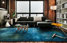 Blue overdyed rug in a modern living room 10 Rooms with Overdyed Rugs