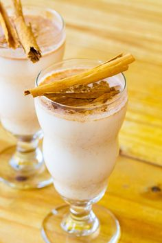 Mexican Horchata Cinnamon & Rice Milk Drink Recipe - white long-grain rice and cinnamon sticks soaked in water, then mixed with milk, sugar, and vanilla extract.