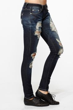 Distressed Skinny Jeans Argghhh! You're trying too hard. The rips and holes are too obvious. Subtlety, jean makers of the world. You're bordering on acid wash.