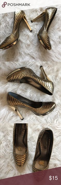 Gold Snakeskin Heels Worn and loved, in good condition. Snakeskin texture, patent gold heel and platform. I had put a sticky comfort pad in for the sole but I took it out. Gianni Bini Shoes Heels