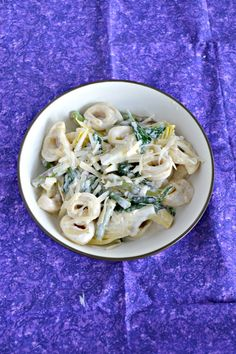 Families will love this easy 20 minute Spinach Artichoke Tortellini with Creamy Lemon Sauce recipe