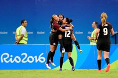 Crystal Dunn #16 of the United States celebrates