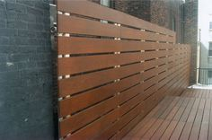 Aluminum poled fence. Love the grey and wood look for the backyard.