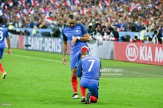 Antoine Griezmann #7 kisses the foot of Dimitri Payet #8 of France to celebrate Payet's goal during the UEFA EURO 2016 Quarter Final match between France and Iceland at Stade de France on July 3, 2016 in Paris, France.