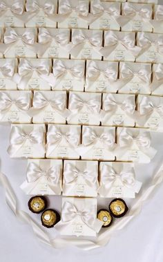 Champagne wedding favor gift boxes with doubled satin ribbon bow and gold names, Elegant personalized bonbonniere for gifts and favors for your guests. #welcomebox #giftbox #personalizedgifts #weddingfavor #weddingbox #weddingfavorideas #bonbonniere #weddingparty #sweetlove #favorboxes #candybox #elegantwedding #partyfavor #weddingwelcome #goldwedding #ivoryandgold #ivorywedding #champagnewedding #uniqueweddingfavors Handmade Wedding Favours, Wedding Gifts For Guests, Destination Wedding Welcome Bag, Wedding Welcome Bags, Champagne Wedding Favors, Wedding Candy Boxes, Wedding Doors, Bachelorette Party Favors, Bridesmaids And Groomsmen