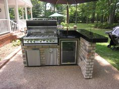 small outdoor rooms | Small Outdoor Kitchen Design Ideas Photo Gallery // I dislike the brick facade and black counter top, but this proves you can have an outdoor kitchen with limited space. This even looks portable,  like it's on wheels.