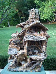 Fairy House.. I LOVE IT!! This is the best one, so much detail, so much, I love all the tiny furniture and just the look of the house and all of it.. I love this one :)
