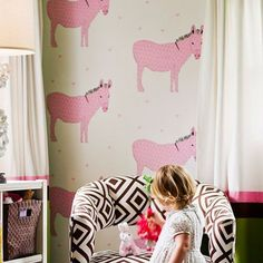 Make wallpaper the centerpiece  In this girl's bedroom, playful wallpaper graces a single wall—a nice technique for a small space. Photo: Thomas J. Story, Sunset.com