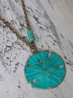This Sand Dollar Necklace is perfect for any outfit.. Brass Vintaj Sand Dollar with hand applied Turquoise Patina Blue, Distressed, Buffed and Sealed for a beautiful finish... #fashion #trendy #boho #necklaces