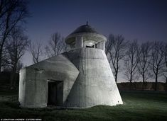 The SK Observation Tower, Fliegerhorst, Hemiksem, Belgium: The Atlantic Wall was built by thousands of forced labourers under the direction of the engineering firm that designed the Siegfried Line between Germany and France