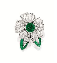 EMERALD AND DIAMOND 'FLOWER' BROOCH, VAN CLEEF & ARPELS. Of floral motif design, centring on a cabochon emerald weighing approximately 3.50 carats, the petals set with brilliant-cut diamonds together weighing approximately 5.00 carats, highlighted to the leaves by calibré-cut emeralds, mounted in platinum, signed and numbered NY51552.