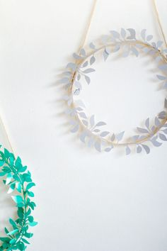 DIY Paper Cut Christmas Wreaths. A great idea for Christmas crafts and decor.
