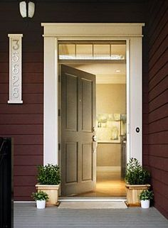 front door with windows blue color of house with white trim front