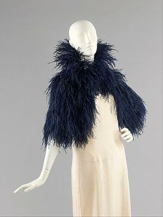 Ostrich feather and silk evening cape, by Caroline Reboux, French, 1930-40. This high-style, chic, and purely decorative evening wrap would have been the ideal accoutrement for making a stylish entrance.
