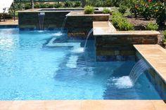 Wet Pools Inc./ Plaster: Quartzscapes, Blue Tahoe/ Travertine coping/ Raised Spa/ March 2011 : Fulshear, Texas