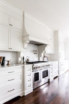 White Kitchen Hood custom range hood in white kitchen | mahshie custom homes | cool