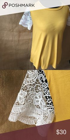 Lace Sleeve Mustard Tee Bright mustard tee with contrasting white lace sleeves.  -Relaxed fit -Rayon/Spandex -Made in US e. Luna Tops