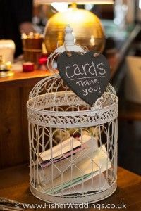 "Birdcage card container for the present table at your bird themed wedding - maybe make place  cards for guests to ""put a bird on it""...pick a bird and put on name place cards!!! Lol"
