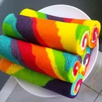 Rainbow cake rolls with icing. Great addition to go with the pinata cake Beaux Desserts, Just Desserts, Delicious Desserts, Yummy Food, Rainbow Food, Taste The Rainbow, Rainbow Cakes, Beautiful Cakes, Amazing Cakes