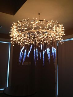 Hulu hoop chandeliers ,  they look awesome in our youth room