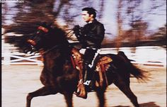 """Elvis riding the horse """"Colonel Midnight"""" that he bought for his dad."""