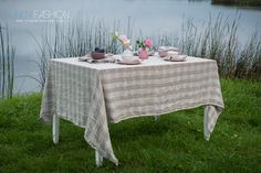 Grey striped washed linen tablecloth. Combine with matching table napkins to complete the look.