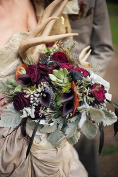 Antler dramatic bouquet with dusty miller, black calla lillies, red roses, succulents