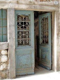 Blue doors with iron grates. make grates like these for the doors Cool Doors, The Doors, Windows And Doors, Porch Doors, Door Knockers, Door Knobs, Door Jamb, Turquoise Door, Aqua Door