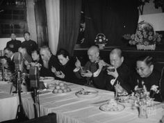 GENERALISSIMO CHIANG KAI-SHEK AND HIS WIFE, EATING AT THE NEW LIFE MOVEMENT DINNER