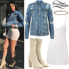 Kylie Jenner posted some pictures on instagram wearing an IRO Frances Dress ($110.00), a Tyler Lambert Distressed Denim Jacket ($395.00), a Cartier Classic Diamonds Bracelet ($11,800.00) and Yeezys Season 2 Knit Ankle Boots ($846.00). You can find a similar denim jacket at New Look (£24.99 – pictured).