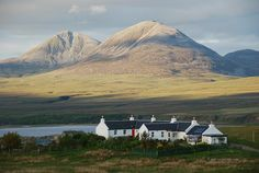 54 Highland conditions.   Cottages at Caol Ila with Paps of Jura in the Background