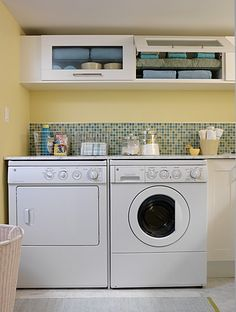 I love how bright and open this laundry room is, and the cabinets above the washer/dryer are a fantastic idea!