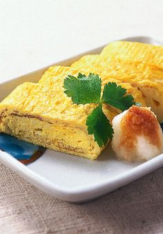 I love tamago! Beautiful picture of a wonderful food. Japanese rolled egg (tamago yaki)