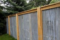 Corrugated metal privacy fence-- this would be beautiful with shrubs in front of it. by tidebuyreviews