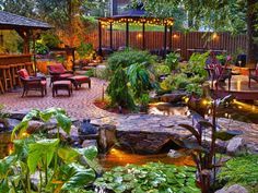 Outdoor Ponds, Water Features and Water Gardens: The garden consists of several varieties of marginal aquatic plants, both tropical and hardy. The tropical plants help provide vibrancy and variety. Maintenance simply requires removing dead foliage so it doesnt fall into the ponds. Design by a target=blank href=http://www.atlantiswatergardens.com/Atlantis Water/a From DIYnetwork.com